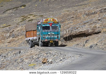 LADAKH INDIA - SEPTEMBER 09 2014: Truck on the high altitude Manali-Leh road in Lahaul valley state of Himachal Pradesh Indian Himalayas India