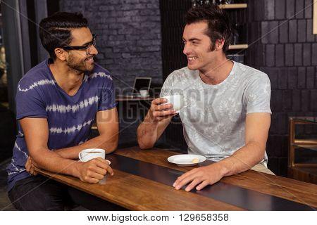 Friends drinking coffee in a coffee shop