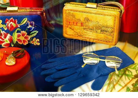Vintage handbags gloves jewelry made of amber glasses.