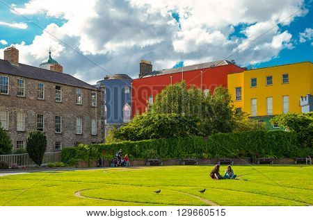 Dublin Ireland - July 30 2013: People in the Dublin Castle gardens