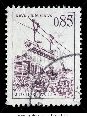 ZAGREB, CROATIA - JUNE 14: A stamp printed in Yugoslavia shows lumber industry, circa 1966, on June 14, 2014, Zagreb, Croatia