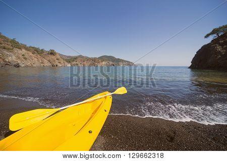 Kayak on the beach on a sunny day near the tent.