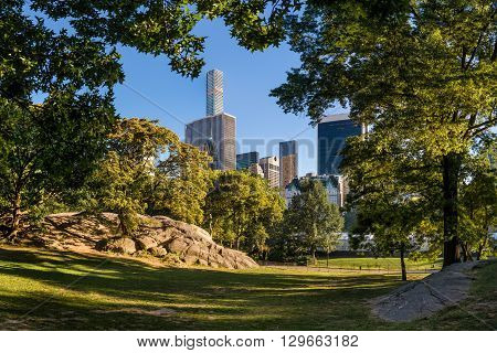 New York City, Central Park in summer light with Midtown Manhattan skyscrapers
