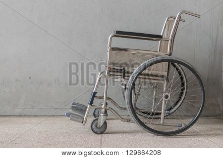 Wheelchair empty wait to use at hospital hallway