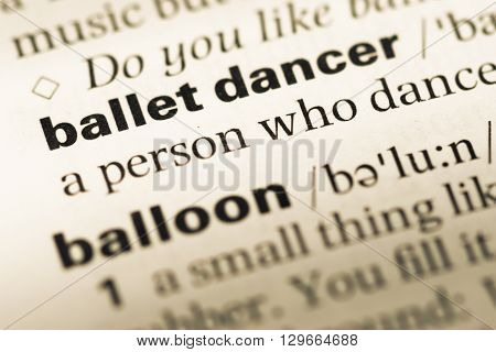 Close Up Of Old English Dictionary Page With Word Ballet Dancer.