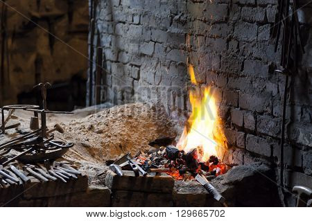Fireplace in a blacksmith's forge with some tools