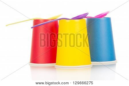 Disposable tableware colorful cups and spoons isolated on white background
