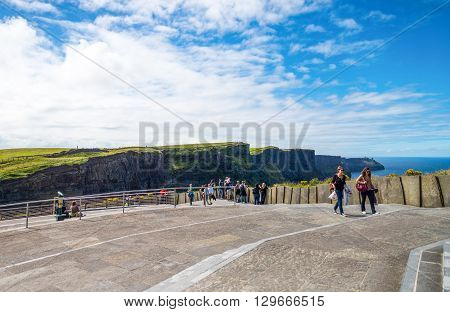Calway Ireland - August 4 2013: Visitors in the Cliffs of Moher look out at the cliffs
