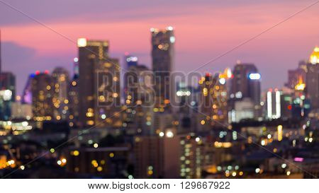 Blurred bokeh lights, city office building with beautiful sky background after sunset