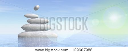 White stones in balance upon water by foggy day with sun