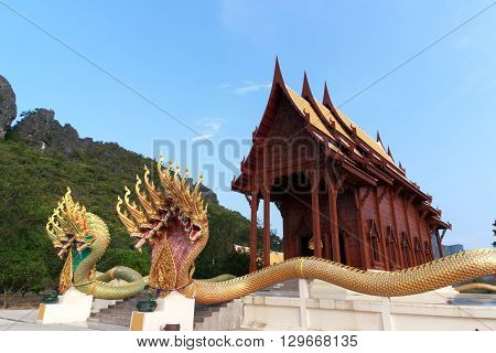 Buddhism temple the teak of worship in Prachuapkirikhan Thailand. Two Naga or dragon nine heads surrounded. (Public area not required Property Release)