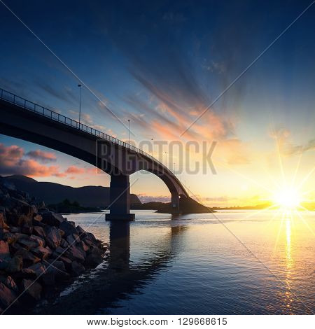 Norway famous bridge at sunset. Norway background. Norway sea. Norway Lofoten island. Norway Lofoten. Norway fjord. Norway famous. Lofoten island. Lofoten road. Lofoten bridge.