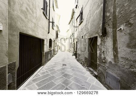 Narrow Alley with Old Buildings in Italian City Vintage Style Toned Picture