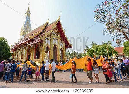 That Phanom Thailand - February 22 2016 : People walk and pray around Wat That Phanom temple during Makha Bucha Day