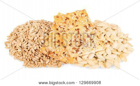 Sunflower seeds and pumpkin seeds, biscuits isolated on white background