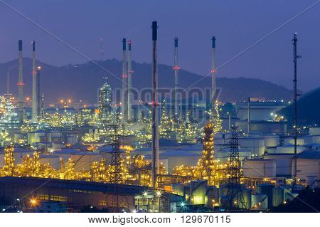 Close up, Oil refinery lights aerial view mountain background, night view