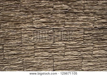 Wood-like bricks texture bricks pattern for exterior or interior design purposes. Fancy plaster coverage of house bricks