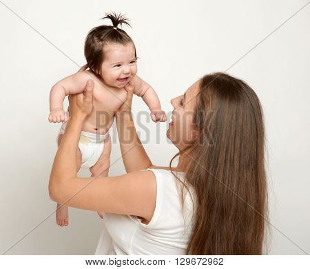 mother lift up baby, play and having fun