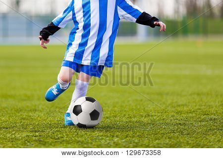 Child Young Boys Kicking Soccer Ball. Kid Playing Soccer.