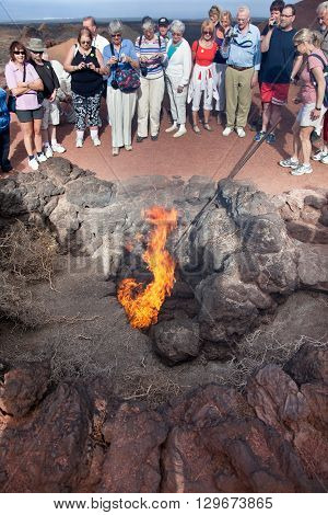 Lanzarote, Spain - October 26 2012: Volcano heat and fire at National Park Timanfaya on the island of Lanzarote Canary Islands Spain