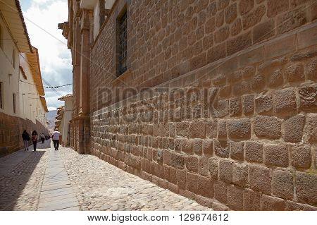People walking the street of Cuzco Peru