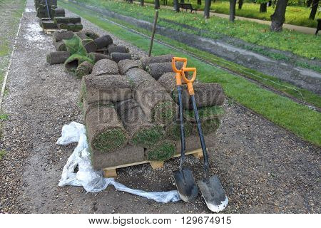Grass In Rolls And Shovels