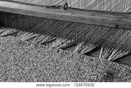 Textile Loom Of Wood With Black And White Color Woolen Threads For The Production Of Woolen Blankets