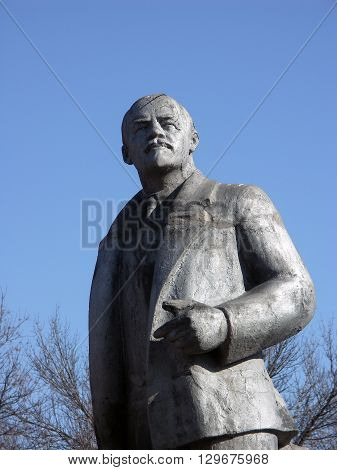 Historical metal monument of Lenin in perspective in small Russian village Shornovo