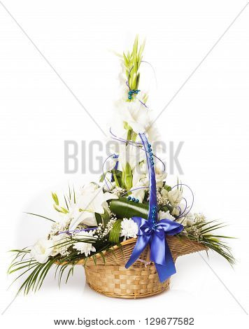 Bouquet from mixed white flowers in basket isolated