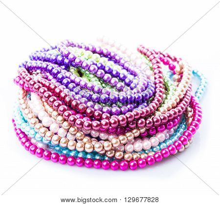 Different colors of beads necklace isolated on white