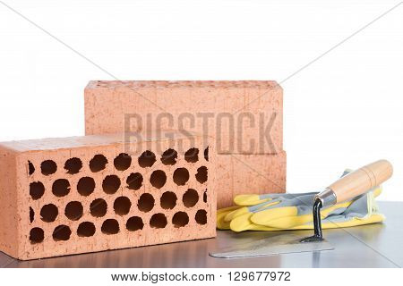 Building material made of bricks and a trowel