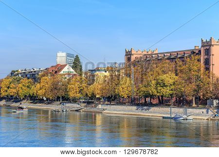 Basel, Switzerland - 31 October, 2014: embankment of the Rhine river. Basel is a city in northwestern Switzerland on the Rhine river, it is Switzerland's third most populous city, after Zurich and Geneva.