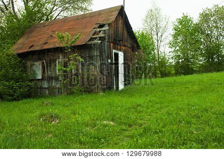 Old abandones lonely house near the forest