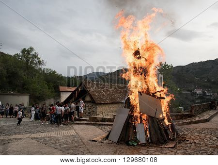 Palaichori Cyprus - May 2 2016: People outside a church with fire burning (lampratzia) Judas Iscariot effigy who betray Jesus Christ for Easter Celepbration at the village of Palaichori in Cyprus