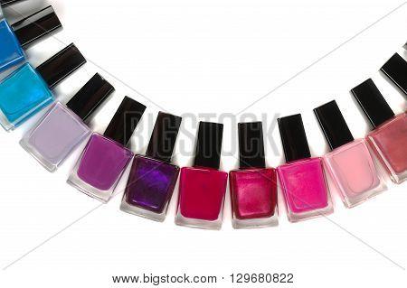 Bottles nail polish semi-circle isolate on the white.