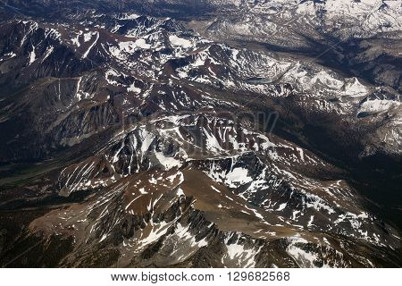 Aerial view of Top of sierra nevada mountains during the summer with a small amount of snow still left on the mountains.