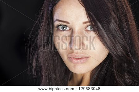 Nice caucasian girl with freckles on face