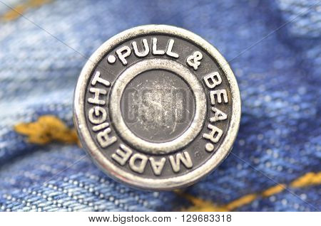 CIRCA MARCH 2016 - GDANSK: Closeup of Pull and Bear button on blue jeans. Pull and Bear is Spanish clothing and accessories retailer. It was founded in 1986 as New Wear, S.A.