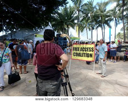 WAIKIKI - JANUARY 30: Free Access Coalition protest Pro Bowl Beach Party posing for cameras on Queens Beach in Waikiki Hawaii January 30 2016.