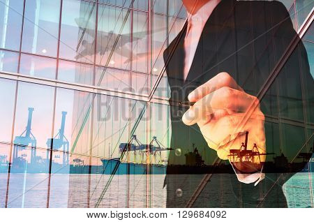 Double Exposure Of Businessman Writing And Port Cargo And Airplane