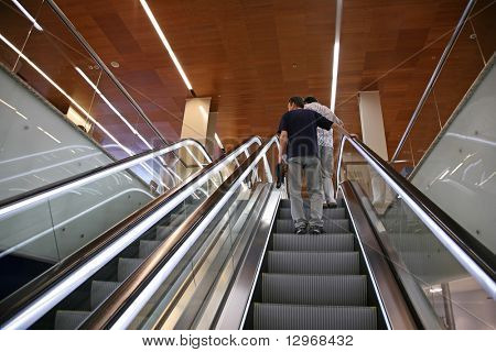 people on the escalator