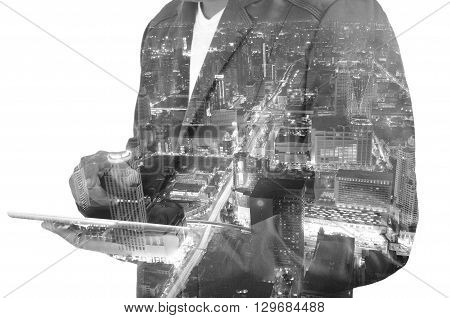 Double Exposure Of A Businessman And A City Using A Tablet Over White Background