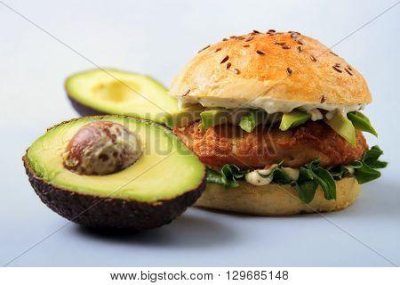 Fish burger with brioche bun mayonnaise and avocado