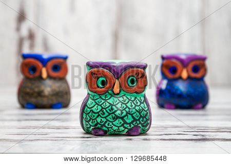 Collection Of Statuettes Of Colorful Owls