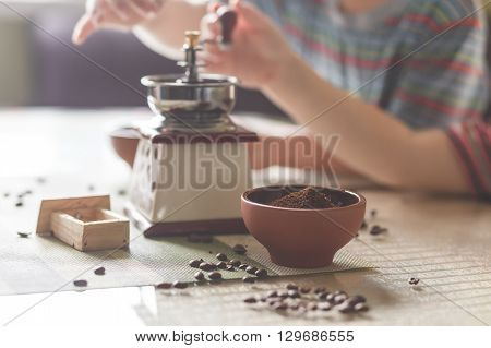 still life with coffee beans and old mill on the table