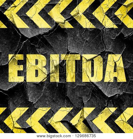 ebitda, black and yellow rough hazard stripes
