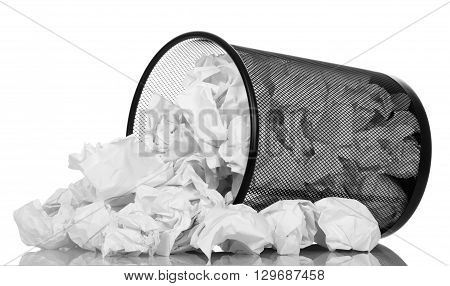 Office basket with crumpled paper isolated on white background