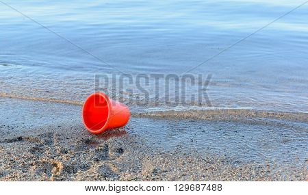 red kids toys on tropical sand beach