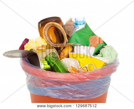 Bin completely filled with household waste isolated on white background