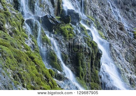Waterfall at talc quarry among the mossy stones